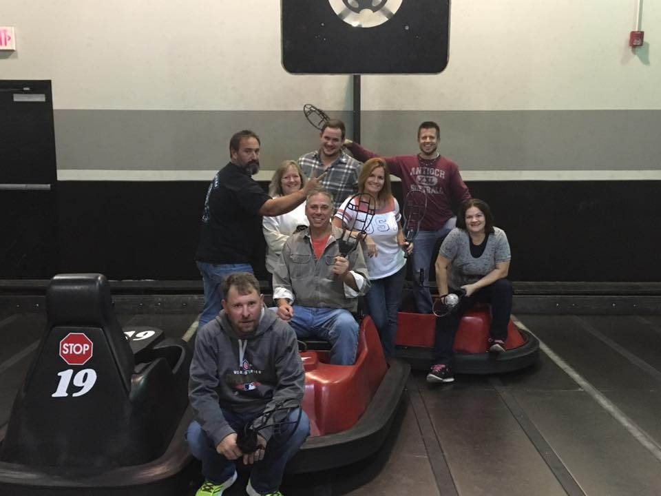 A-action pest control team out for a day of bumper cars