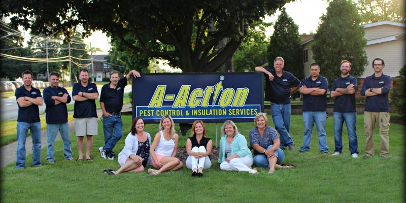 A-Action team of exterminators in front of and next to the A-Action sign. Join the team of pest control experts today!