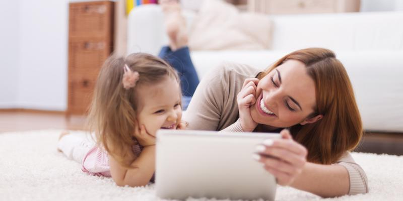mother and daughter using ipad